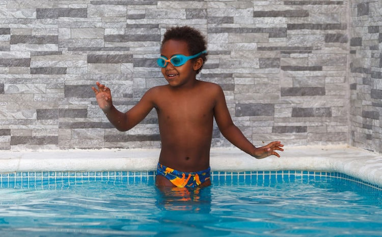 child in a swiming pool